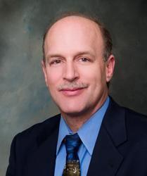 Kenneth M. Adams